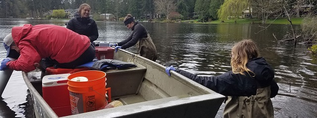 UW SRP Center researchers collect water samples from Lake Killarney, a well-mixed shallow lake in the study.