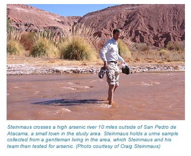 A photo of Craig Steinmaus crossing a high arsenic river in northern Chile.