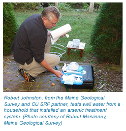 Photo of Robert Johnson from the Maine Geological Survey testing well water.